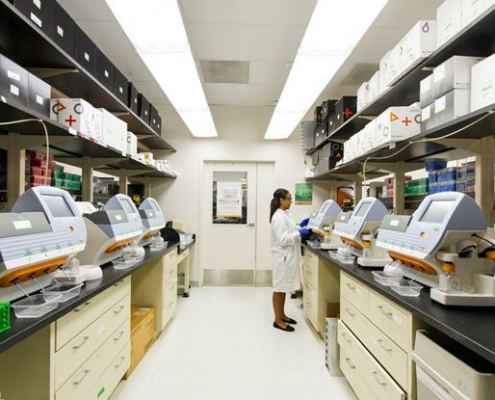 A researcher working in a less spacious lab